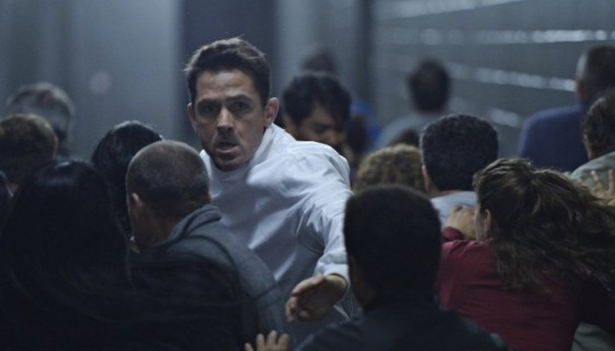 Dr. Farragut (Billy Campbell) pushes through the rampaging crowd of people on SyFy's new show Helix. Courtesy of SyFy.